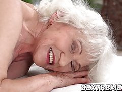 Horny granny Norma needs young hard cock on a massage table